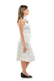 Ritratto integrale di una donna che si leva in piedi in una riga Fotografia Stock