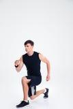 Ritratto integrale di uno scaldarsi dell'uomo di sport Fotografia Stock Libera da Diritti
