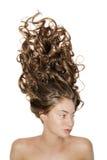 Ritratto isolato della ragazza con capelli ricci lunghi Fotografia Stock