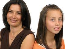 Ritratto isolato di una madre con la figlia Fotografia Stock