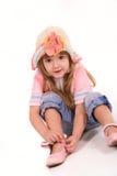 Ritratto piacevole della bambina su bianco Fotografia Stock