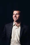 Ritratto scuro di un uomo sorridente di affari Immagini Stock