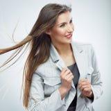 Ritratto sorridente della donna di affari Isolato su priorità bassa bianca Immagine Stock