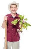 Ritratto verticale di un agricoltore con il raccolto della barbabietola in sua mano Fotografie Stock Libere da Diritti
