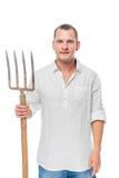 Ritratto verticale di un agricoltore con le forcelle in sua mano su un bianco Fotografie Stock Libere da Diritti