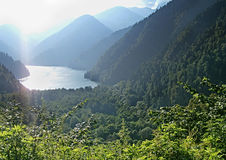 Rits's mountain lake in the mountains of the Caucasus. Stock Photos
