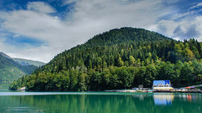 Ritsa lake in the mountains. Under the blue sky Royalty Free Stock Images