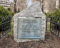 Rittenhouse Square, one of Philadelphia`s original squares, and on the National Register of Historic Places. Pictured is a metal placard embedded in granite royalty free stock photo