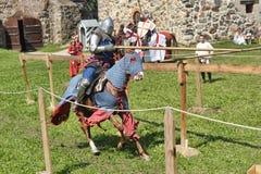 Ritter auf Pferdeturnier Stockfotos