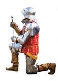 Ritter auf verbogenem Knie Stockbilder