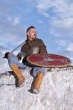 Ritter, der auf einem Felsen sitzt Stockfotos