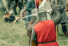 RITTER WEG, MOROZOVO, APRIL 2017: Festival of the European Middle Ages. Medieval joust knights in helmets and chain mail battle on. Swords with shields in their royalty free stock photo