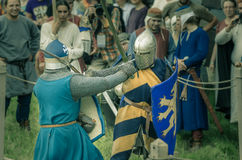 RITTER WEG, MOROZOVO, APRIL 2017: Festival of the European Middle Ages. Medieval joust knights in helmets and chain mail battle on Stock Images