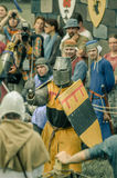 RITTER WEG, MOROZOVO, APRIL 2017: Festival of the European Middle Ages. Medieval joust knights in helmets and chain mail battle on. Swords with shields in their royalty free stock images
