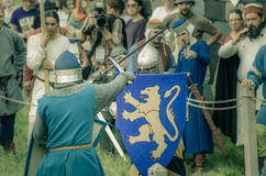 RITTER WEG, MOROZOVO, APRIL 2017: Festival of the European Middle Ages. Medieval joust knights in helmets and chain mail battle on. Swords with shields in their royalty free stock photos