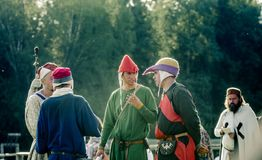RITTER WEG, MOROZOVO, APRIL 2017: Reconstruction roleplay festival. A group of male judges conferring in a circle after Royalty Free Stock Images