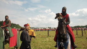 RITTER WEG, MOROZOVO, JUNE 2016: Festival of the European Middle Ages. Medieval knights on horseback drinks water and stock video footage