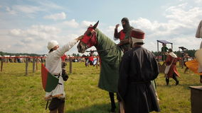 RITTER WEG, MOROZOVO, JUNE 2016: Festival of the European Middle Ages. Medieval knights on horseback pours a horse stock video footage