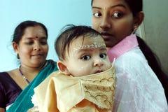 Rituais de Annaprashana em India Fotografia de Stock