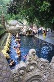 Ritual Bathing Ceremony, Bali Indonesia. Ritual Bathing Ceremony at Tampak Siring, Bali Indonesia Stock Photo