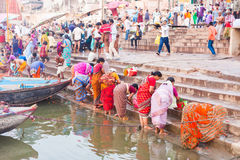 Ritual bathing in the River Ganges. VARANASI, INDIA - 28 Oct 2016: Hindu pilgrims bathe in the River Ganges at dawn at Dashaswamedh Ghat on October 28, 2016 in Stock Images