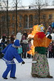 The ritual of burning effigies of the spirit of winter carnival at national public holiday. Stock Photography