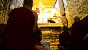 Ritual commences monks wash the face and brush the teeth of the Buddha image stock video