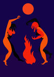 Ritual dance by the fire. Two naked woman dance the night near the fire Royalty Free Stock Photos