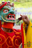 Ritual dances from Buthan in NY. Thirteen monks from the monastery fortress of Trongsa in central Bhutan perform the mesmeric ritual demon subjugation dances in Royalty Free Stock Images