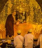 The ritual of daily face washing Mahamuni Buddha in Mandalay, Myanmar Royalty Free Stock Images