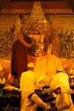 The ritual of daily face washing Mahamyatmuni Buddha. Royalty Free Stock Images