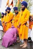 Ritual feet washing during Baisakhi procession Royalty Free Stock Image