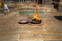Ritual fire puja near the temple Stock Photo