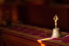 Hand bell, enlightenment and sunlight. Ritual hand bell in the Buddhist temple as the enlightenment symbol, has got to a sunlight beam royalty free stock photography