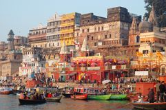 Ritual morning bathing at sacred Varanasi ghats,india. Indian people are walking near ghats after ceremony of daily morning bathing in the Ganges River on Stock Images