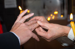 Ritual placement of wedding rings. Stock Image