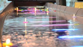 Ritual praying colorful candle floating on water for pray buddha stock footage