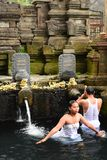 Ritual purifying bath in the temple pond. Tirta Empul. Tampaksiring. Gianyar regency. Bali. Indonesia stock image