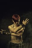 Ritual. Redhead naked gothic man posing over dark background Royalty Free Stock Images