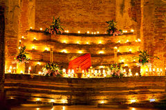 Ritual stand. Monastery burning candles at Ritual stand at night Royalty Free Stock Images