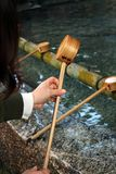 A ritual to purify the pilgrim. In Japanese, it`s called. `Temizuya` or `Chozuya`. Taken in Fukuoka, Japan, February 2018 royalty free stock photo