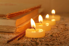 Rituals. Esoteric atmosphere created with candles, old books and incense Royalty Free Stock Photos