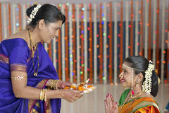 Rituals in Indian Hindu wedding showing respect and blessings. Stock Photo