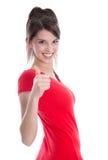 Riuscita donna castana isolata con il pollice su. Fotografia Stock