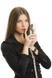 Riuscita donna di affari che gesturing silenzio di conservazione Immagine Stock