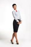 Riuscita donna felice di affari con il blocchetto per appunti Fotografia Stock