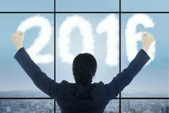 Riuscita donna in ufficio con i numeri 2016 Immagini Stock Libere da Diritti