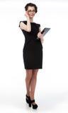 Riuscita signora di affari in vetri e nel lapt nero Fotografia Stock Libera da Diritti