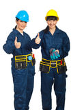 Riuscite donne degli operai che danno i pollici Fotografia Stock