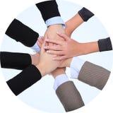 Riuscite donne di affari con il loro togethe delle mani Immagini Stock Libere da Diritti